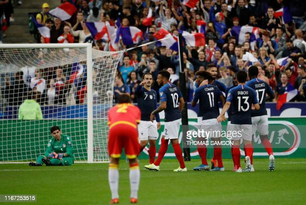France's players celebrates after forward Kingsley Coman scored a goal during the UEFA Euro 2020 qualifying Group H football match between France and...