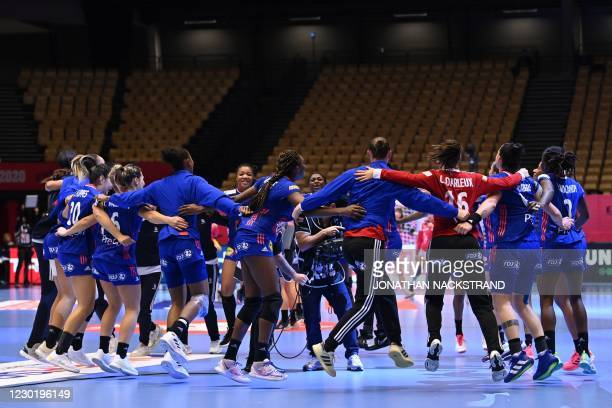 France's players dance as they celebrate their team's 30-19 win after the semi-final match between France and Croatia of the 2020 EHF European...