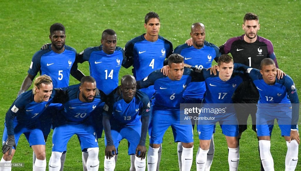 France's players (Front Row, From L) forward Antoine Griezmann, forward Alexandre Lacazette, defender N'golo Kante, defender Corentin Tolisso, defender Lucas Digne and midfielder Kylian Mbappe and (Back Row, From L) defender Samuel Umtiti, midfielder Blaise Matuidi, defender Raphael Varane, defender Djbril Sidibe and goalkeeper Hugo Lloris pose for a team photo prior to the FIFA World Cup 2018 qualifying football match between Bulgaria and France at The Vasil Levski Stadium in Sofia on October 7, 2017. / AFP PHOTO / Nikolay DOYCHINOV