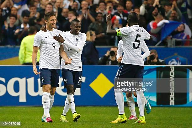 France's players forward Olivier Giroud forward Blaise Matuidi and defender Mamadou Sakho celebrate after Giroud scored a goal during a friendly...