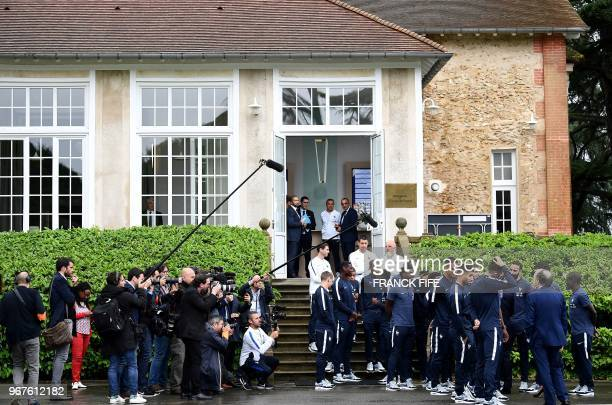 France's players gather to meet French President Emmanuel Macron as he visits the team's training grounds in ClairefontaineenYvelines southwest of...