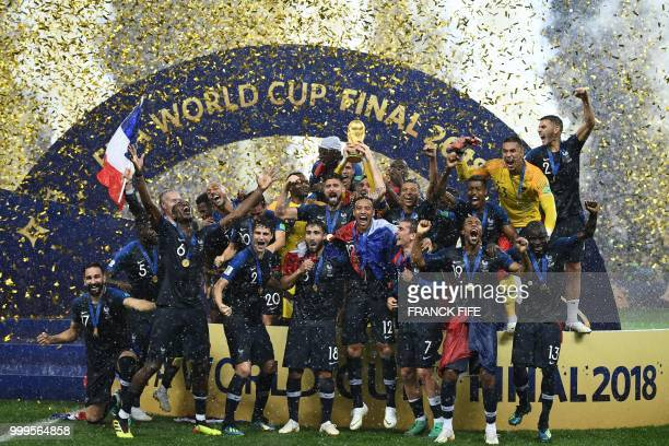 France's players hold their World Cup trophy as they celebrate their win during the trophy ceremony at the end of the Russia 2018 World Cup final...