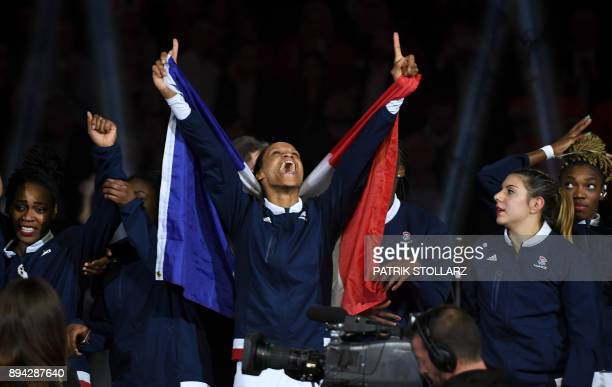 France's players including Allison Pineau celebrate after winning the IHF Womens World Championship handball final match between France and Norway on...