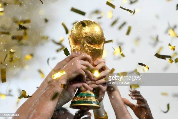 TOPSHOT France's players lift the Fifa World Cup trophy after the Russia 2018 World Cup final football match between France and Croatia at the...
