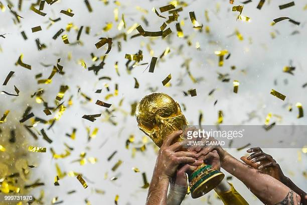 TOPSHOT France's players lift the World Cup trophy after winning the Russia 2018 World Cup final football match between France and Croatia at the...