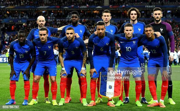 France's players line up prior to the friendly football match France vs Spain on March 28 2017 at the Stade de France stadium in SaintDenis north of...