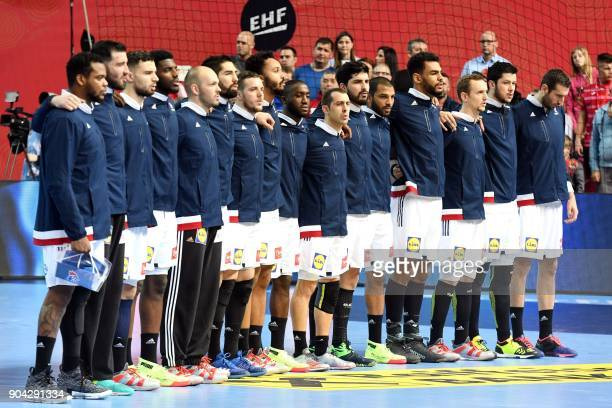 France's players listen to the anthem prior to the preliminary round group B match of the Men's 2018 EHF European Handball Championship between...