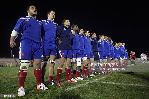 France's players listen to the national anthems prior their 6 Nations Rugby Under 20 match at Tomaselli Stadium on February 1 2013 AFP PHOTO /...