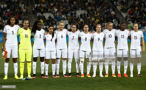 France's players listen to their national anthem before their Rio 2016 Olympic Games women's football quarterfinal match against Canada at the...
