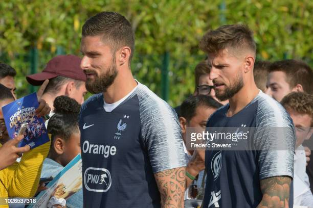 France's players Olivier Giroud and Benoit Costil arrive to a training session at the French national football team centre in...