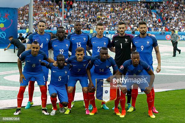 France's players pose for a team photo prior to the Euro 2016 group A football match between France and Romania at Stade de France in SaintDenis...