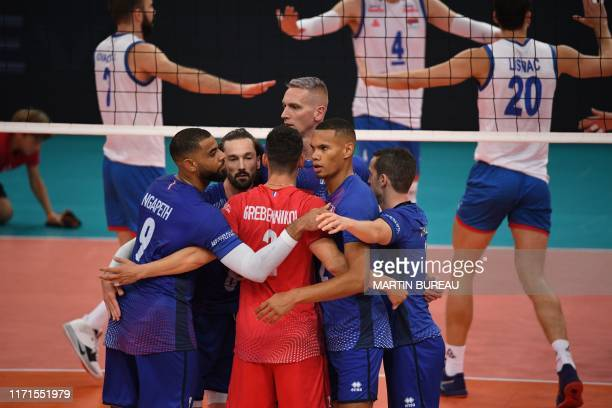 France's players react after a point during the the Men's 2019 CEV Volleyball European Championship semifinal match between France and Serbia at the...