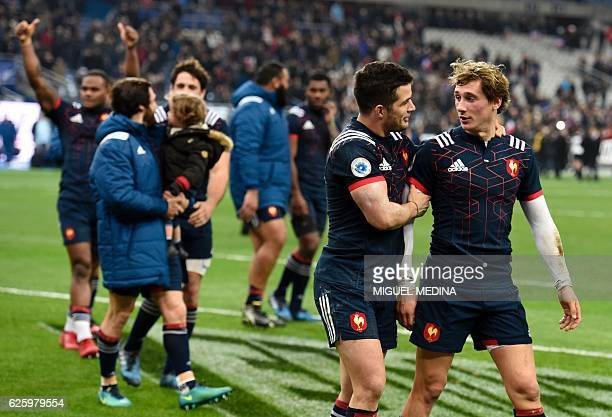France's players react after loosing the rugby union Test match between France and New Zealand on November 26 at the Stade de France in SaintDenis...