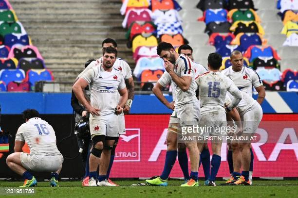 France's players react after losing the Six Nations rugby union tournament match between France and Scotland on March 26 2021, at the Stade de France...