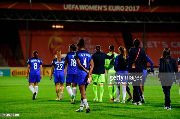 France's players react after the UEFA Women's Euro 2017 tournament quarterfinal football match between England and France at Stadium De Adelaarshorst...