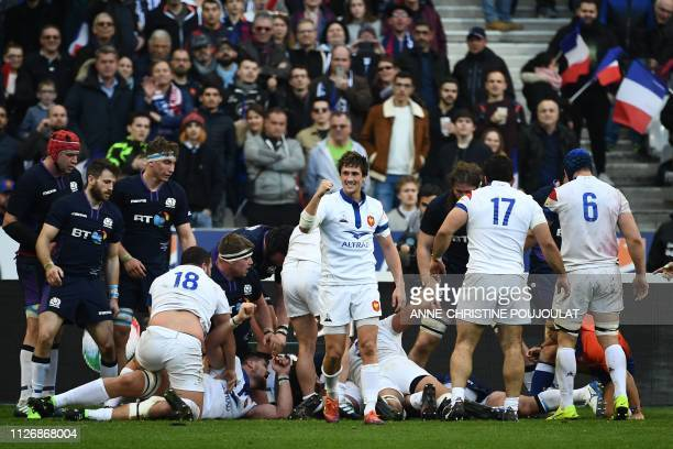 France's players react after their fourth try during the Six Nations rugby union tournament match between France and Scotland at the Stade de France...
