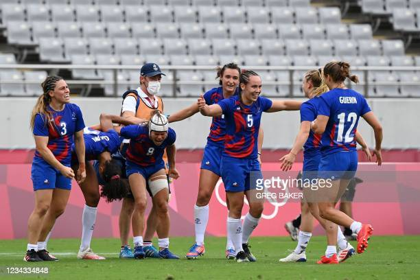 France's players react after winning the women's rugby sevens semi-final match between France and Britain during the Tokyo 2020 Olympic Games at the...