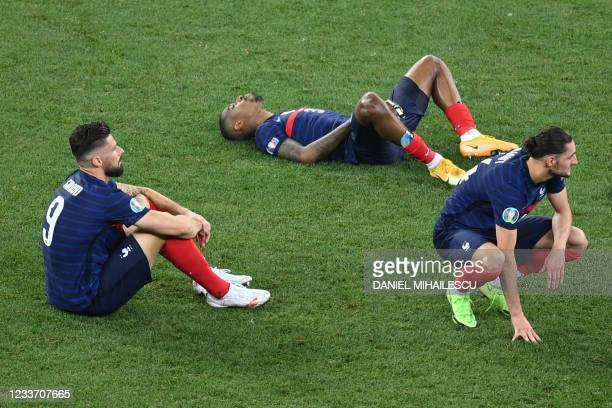 France's players react to their defeat after the penalty shootout during the UEFA EURO 2020 round of 16 football match between France and Switzerland...