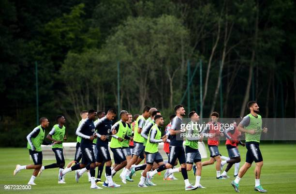 TOPSHOT France's players run during a training session in ClairefontaineenYvelines on June 4 as part of the team's preparation for the upcoming FIFA...