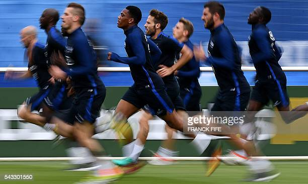 France's players run during a training session in Clairefontaine-en-Yvelines, southwest of Paris, on June 6 during the Euro 2016 football tournament....