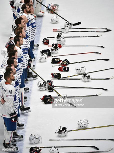 France's players sing the national anthem after their 62 victory during the group B preliminary round game Hungary vs France at the 2016 IIHF Ice...