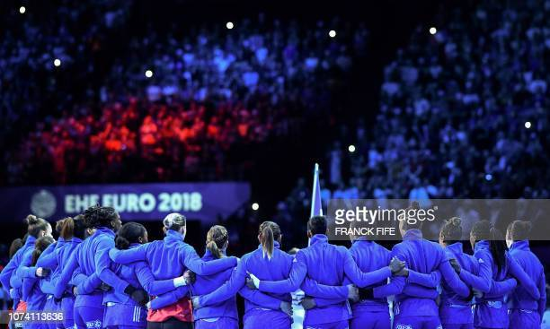 France's players stand prior to the EHF EURO 2018 European Women's Handball Championship Final match between Russia and France at the AccorHotels...