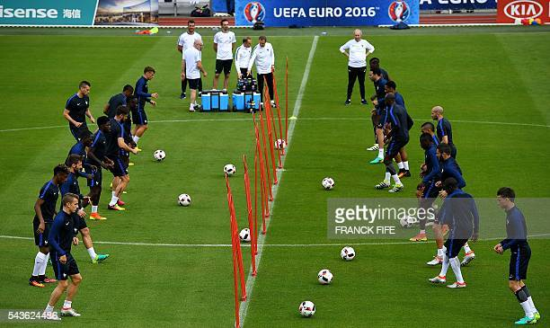 France's players take part in a training session in ClairefontaineenYvelines southwest of Paris on June 29 during the Euro 2016 football tournament /...