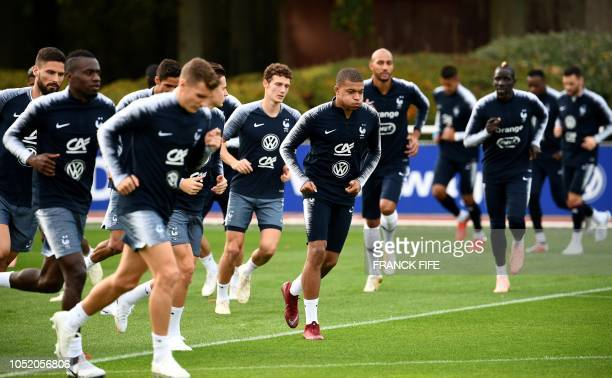 France's players warm up during a training session in Clairefontaine-en-Yvelines on October 13 as part of the team's preparation for the upcoming...