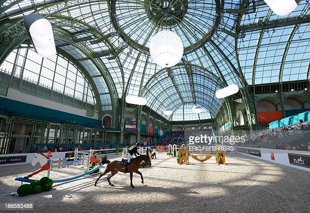 France's Pénélope Leprevost riding Nice Stéphanie competes in the International Jumping Competition 'Grand Prix Hermes' on April 14 at the Grand...