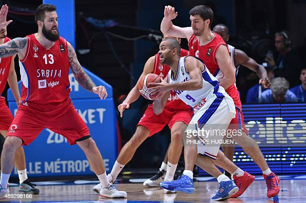 France's point guard Tony Parker dribbles during the third place basketball match between France and Serbia at the EuroBasket 2015 in Lille northern...