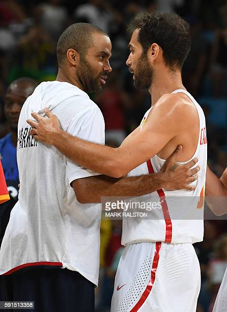 France's point guard Tony Parker greets Spain's point guard Jose Manuel Calderon after the Men's quarterfinal basketball match between Spain and...