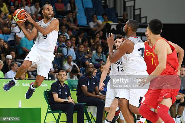 TOPSHOT France's point guard Tony Parker passes the ball during a Men's round Group A basketball match between France and China at the Carioca Arena...