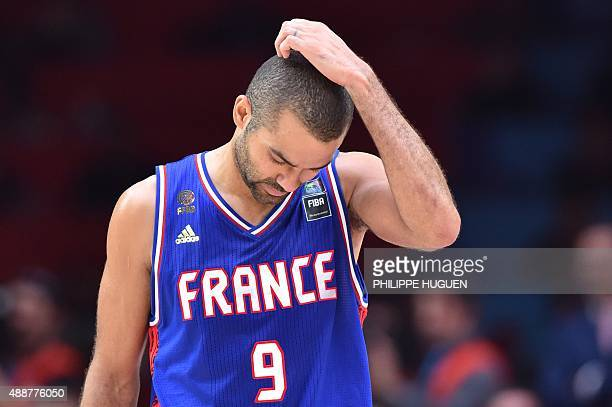 France's point guard Tony Parker reacts after Spain defeated France in the semifinal basketball match between Spain and France at the EuroBasket 2015...