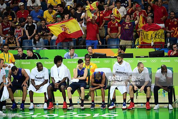 France's point guard Tony Parker sits on the bench in the last minutes during a Men's quarterfinal basketball match between Spain and France at the...