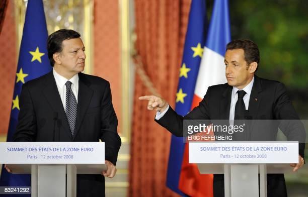 France's President and current European Union president Nicolas Sarkozy speaks next to European Commission President Jose Manuel Barroso during a...