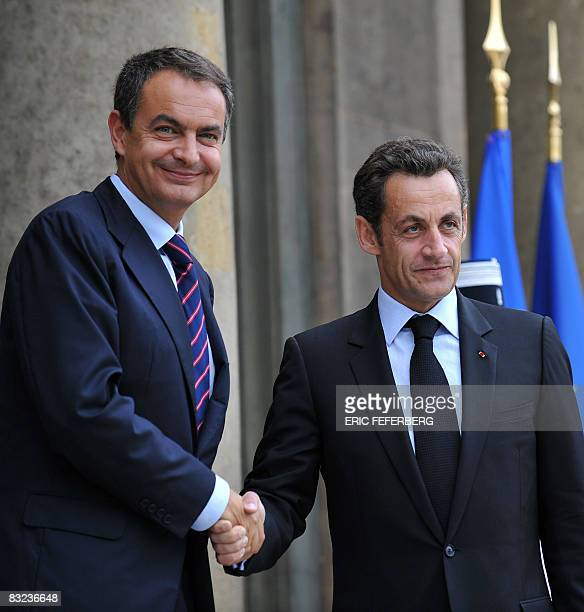 France's President and current European Union president Nicolas Sarkozy welcomes Spain's Prime Minister Jose Luis Zapatero as he arrives to attend a...