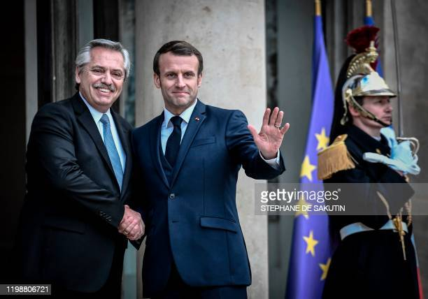 France's President Emmanuel Macron and Argentina's President Alberto Fernandez shake hands during their meeting at the Elysee Palace in Paris on...