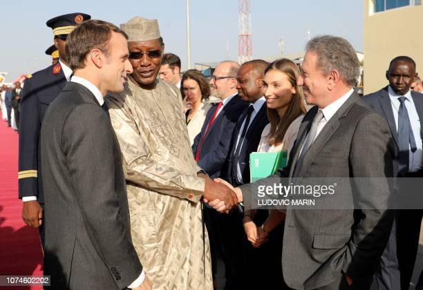 France's president Emmanuel Macron and Chad's president Idriss Deby greet French TV celebrity Michel Drucker preparing a broadcast on Barkhane...