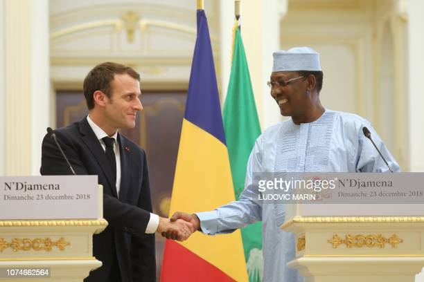 France's president Emmanuel Macron and Chad's president Idriss Deby shake hands as they hold a press conference at the presidential palace in...
