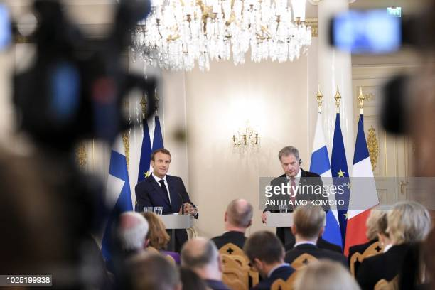 France's President Emmanuel Macron and Finland's President Sauli Niinistö address a press conference after their meeting at the Presidential Palace...