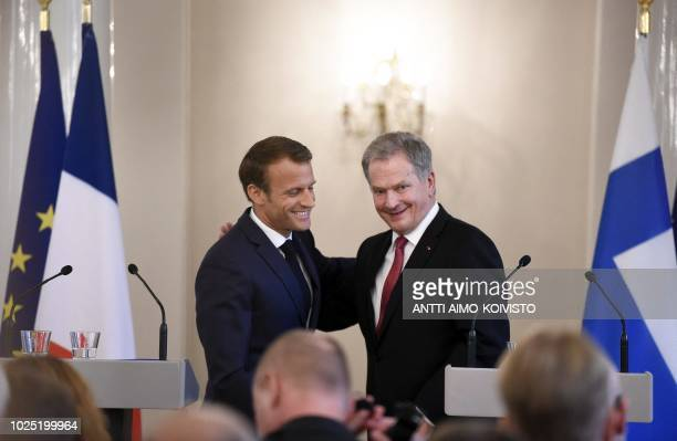 France's President Emmanuel Macron and Finland's President Sauli Niinistö conclude their joint press conference after their meeting at the...