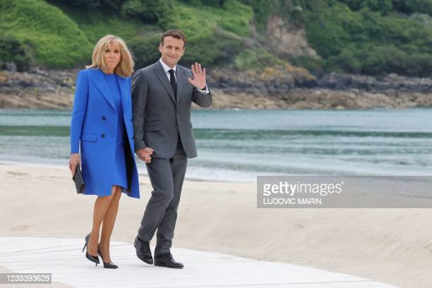 France's President Emmanuel Macron and France's First Lady Brigitte Macron arrive for the welcome prior to the start of the G7 summit in Carbis Bay,...
