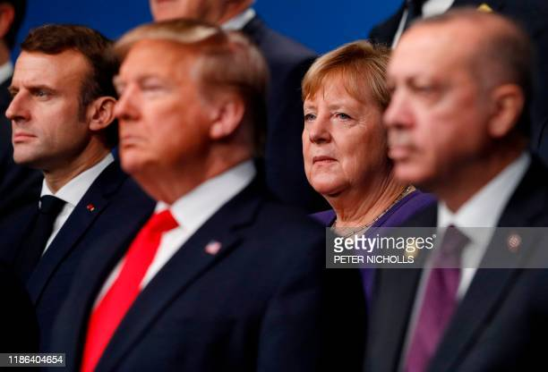 France's President Emmanuel Macron and German Chancellor Angela Merkel pose with NATO leaders including US President Donald Trump and Turkey's...