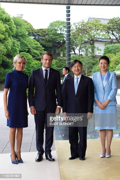 France's President Emmanuel Macron and his wife Brigitte Macron are greeted by Japan's Emperor Naruhito and Empress Masako at the Imperial Palace in...