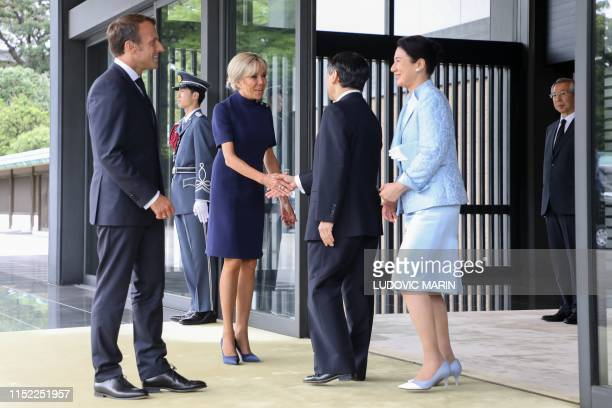 France's President Emmanuel Macron and his wife Brigitte Macron bid farewell to Japan's Emperor Naruhito and Empress Masako at the Imperial Palace in...