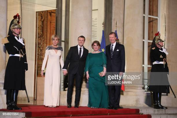 France's President Emmanuel Macron and his wife Brigitte Macron greet Grand Duke Henri of Luxembourg and Grand Duchess of Luxembourg MariaTeresa upon...