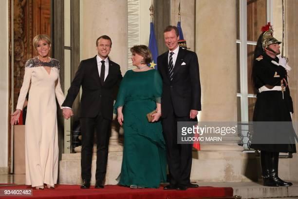 France's President Emmanuel Macron and his wife Brigitte Macron greet Grand Duke Henri of Luxembourg and Grand Duchess of Luxembourg Maria-Teresa...
