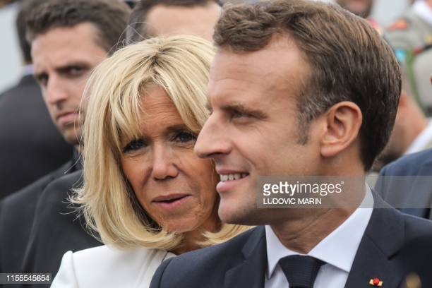 France's President Emmanuel Macron and his wife Brigitte Macron look on at the end of the annual Bastille Day military parade down the ChampsElysees...