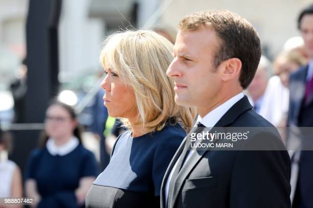 France's President Emmanuel Macron and his wife Brigitte Macron pay their respects by the coffins of former French politician and Holocaust survivor...