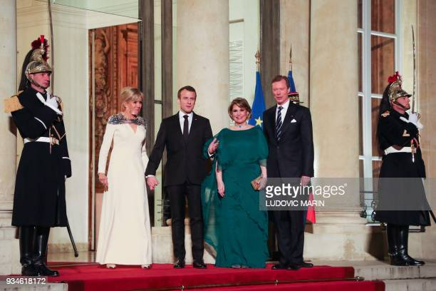 France's President Emmanuel Macron and his wife Brigitte Macron pose as they greet Grand Duke Henri of Luxembourg and Grand Duchess of Luxembourg...